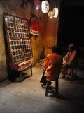 A game of Go, Vietnam by Julia Bond, Photography